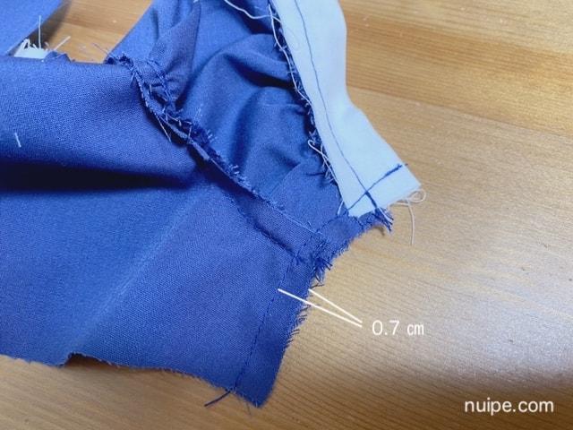 わきを縫う